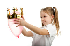 Girl playing with a crown Stock Photography