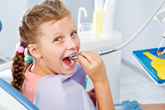 Girl playing with dental drill Royalty Free Stock Image