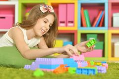 Girl playing with designer Royalty Free Stock Image