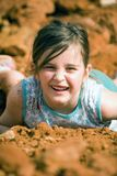 Girl Playing in Dirt. Oh yeah, get down and play in the dirt and make your mother mad! Childhood happiness royalty free stock photo