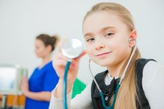 Girl Playing Doctor Royalty Free Stock Photo