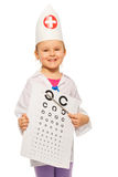 Girl playing doctor dressed in oculist costume Royalty Free Stock Images