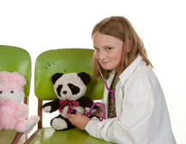 Girl playing doctor with her toys Royalty Free Stock Photography