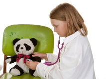 Girl playing doctor with her toys Stock Photography