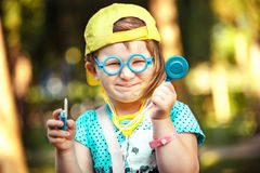 Girl playing doctor Royalty Free Stock Photos