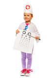 Girl playing doctor with pointer and testing card Stock Photos