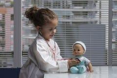 Girl playing doctor Stock Photos