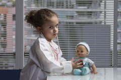 Girl playing doctor Royalty Free Stock Images