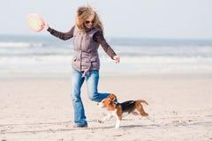 Girl playing with dog stock image