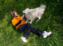 Girl playing with dog Royalty Free Stock Image