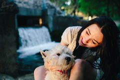 Girl playing with a dog Stock Photography