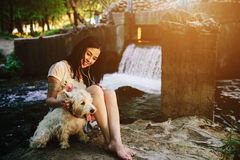 Girl playing with a dog Stock Photos