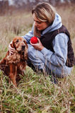 Girl playing with dog Stock Images
