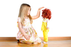 Girl playing with doll Royalty Free Stock Image