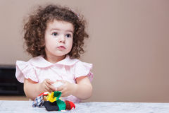 Girl playing with a doll Royalty Free Stock Photography