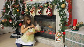 Girl playing with doll stock footage