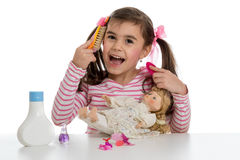 Girl playing with doll Stock Photos
