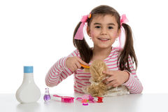 Girl playing with doll Stock Photography