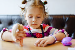 Girl playing dolls Stock Photography
