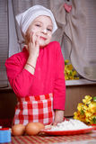 Girl playing with dough in kitchen Royalty Free Stock Image