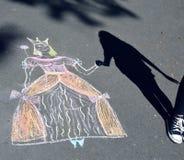 Girl playing with drawn princess Stock Photo