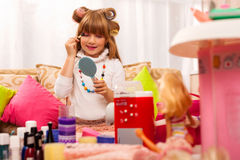 Girl playing dress up Stock Images