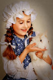 Girl playing with Easter bunny. Stock Photography