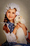 Girl playing with Easter bunny. Royalty Free Stock Photo