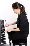 Girl playing on electric piano Royalty Free Stock Images