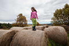 Girl Standing Farm Bales Stock Photo