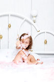 Girl playing with feathers Royalty Free Stock Photography