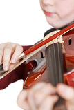 Girl playing fiddle by bow isolated Royalty Free Stock Photos