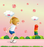 A girl playing at the field with candy balls floating. Illustration of a girl playing at the field with candy balls floating Royalty Free Stock Photos