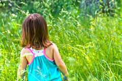 Girl playing in a field Stock Photos