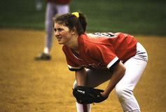 A girl playing first base in a softball game stock photography