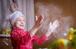 Girl playing with flour in kitchen Royalty Free Stock Image
