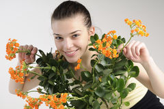 girl playing with flowers Stock Photography