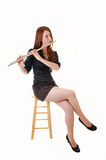 Girl playing flute. Royalty Free Stock Photos
