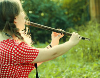 Girl playing at the flute Royalty Free Stock Photo