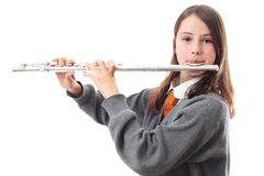 Girl playing flute. A school girl playing a flute Stock Photos