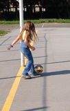 Girl playing football. Long haired six years old girl kicking soccer ball Stock Image