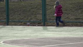 Girl Playing Football. Baby with Ball on Sports Field. 4k Ultra HD stock video