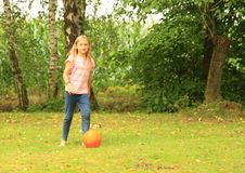 Girl playing football Stock Photography