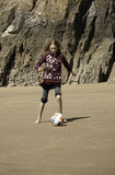Girl Playing Football on the Beach Stock Photos