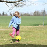 Girl playing football Royalty Free Stock Photography