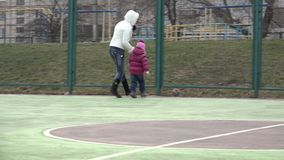 Girl Playing Football with Mother on Sport Playground.. 4K UltraHD, UHD stock video