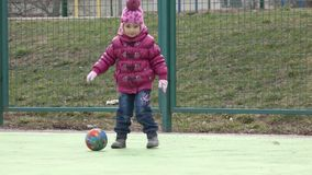 Girl Playing Football with Mother on Sport Playground.. 4K UltraHD, UHD stock video footage