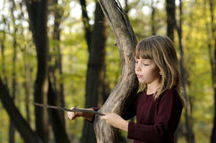 girl playing in forest Stock Photography