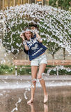 Girl playing in fountain Stock Image