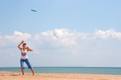 Girl playing frisbee Stock Photos